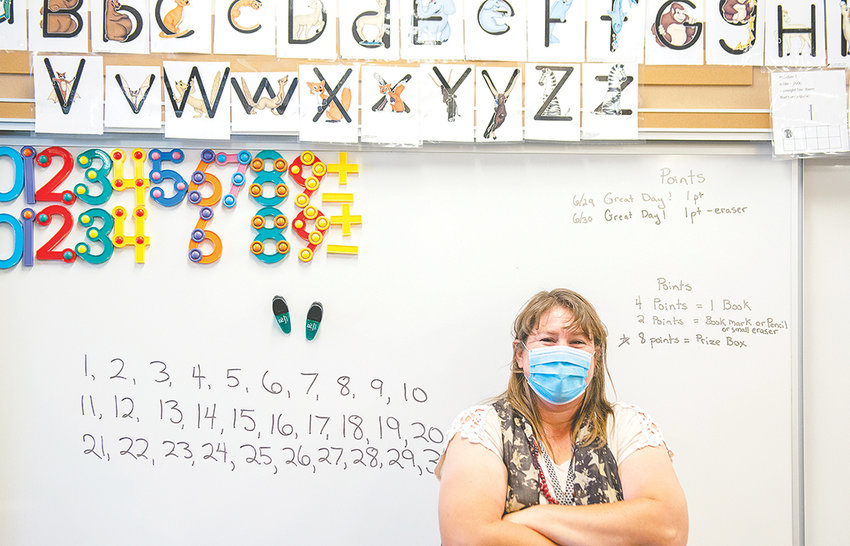 Southside Elementary School teacher Christy Muecke poses for a photograph in her classroom on Wednesday. Muecke returned to her classroom this week for an extended school year to work with a student on an individualized education program. Summer school starts next week.