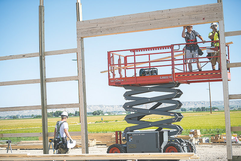 Trace Jester and Johnny Padilla work on squaring up a header for one of the large doors on the new PHS ag building on Wednesday. The new PHS ag building, located north of the shot put ring and tennis courts, is set to be completed this fall.