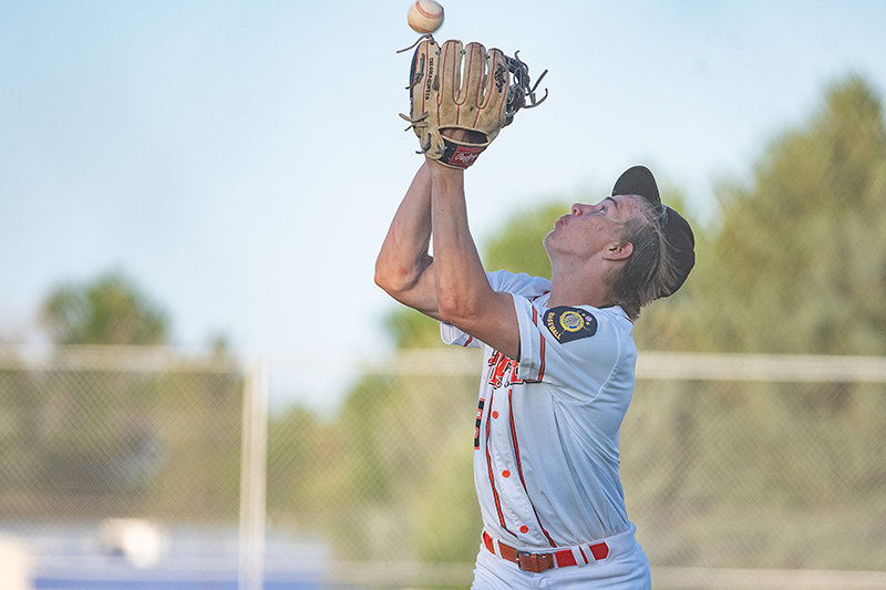 Outfielder Kobe Ostermiller makes a catch on the warning track against the Billings Cardinals. Powell won the second game of Friday's doubleheader for its ninth win of the season.