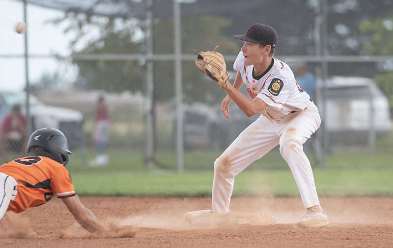 Trey Stenerson prepares to tag out a runner at second base in the Pioneers' game against Torrington. Powell dropped the contest 7-3, ending its season.