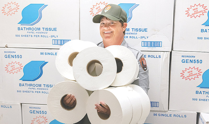 A Yellowstone National Park facility management employee shows off an abundance of toilet paper in the park this summer. But with camping and other overnight facilities closed due to the pandemic, visitors are camping outside the park and finding bathroom and shower facilities scarce. The result is human waste littering the area.