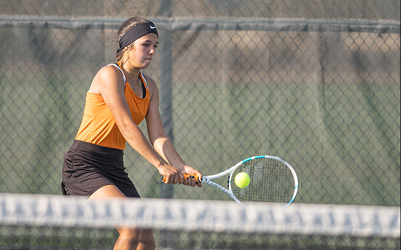 PHS No. 3 doubles player Kaili Wisniewski hits a ball in Powell's match against Cody on Tuesday. Both the girls' and boys' teams lost to the Broncs, moving their records to 2-3.