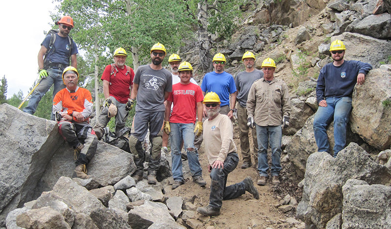 A group of volunteers, Forest Service employees and members of the Wyoming State Trail crew recently put in more than three days of work to get a Bighorn National Forest trail back into usable condition.