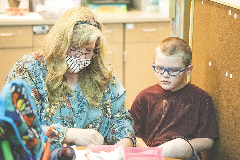 Southside Elementary School teacher Katie Bott works with Alex Phillips earlier this month. Bott serves as the life skills elementary teacher for Park County School District No. 1 and was named the district's Teacher of the Year.