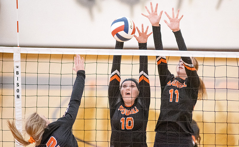 Ashlyn Shorb and Addy Thorington go up for a block in Saturday's home match against Worland. The Panthers dropped the contest in three sets.