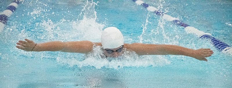 PHS freshman Croix Tryon swims the 100 butterfly at the varsity triangular on Thursday. Her time of 1:15.98 was good for a state qualifying time.