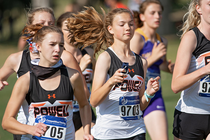 PHS runners Gabby Thomas (left) and Meaghan McKeen participate in the Pinnacle Bank Powell Invite at Powell Golf Club. Both the girls' and boys' teams placed fourth at the event.