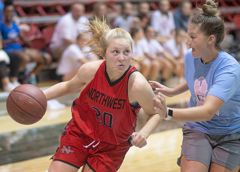 NWC guard Shelby Tarter drives for a layup at Northwest's Oct. 7 practice on Wednesday. She dropped 17 points at Cabre Gym against NWC last year as a member of Sheridan's team.
