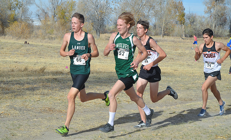 Powell High School sophomore Daniel Merritt (back center) and teammate Joey Hernandez run hot on the trail of Greg Sherwin of Green River during Friday's Class 3A West Conference Championships in Riverton. Merritt finished 19th and Hernandez 24th to lead the Panther boys.