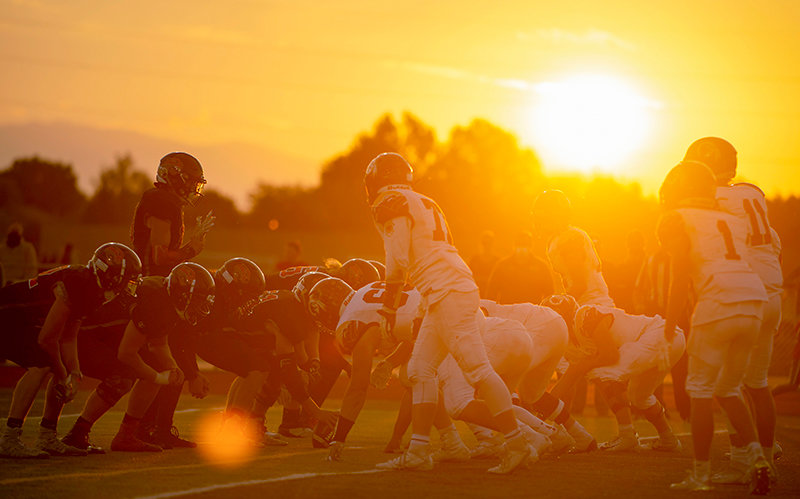The Panther offense awaits a snap in the third quarter of Powell's game against Star Valley on Friday, Oct. 2, as the sun sets on Panther Stadium. The Powell High School boys are 5-2 so far this season.