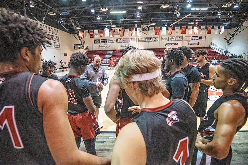 Head coach Jay Collins speaks with members of the Northwest College men's basketball team during Saturday's scrimmages against Dawson Community College and Western Wyoming Community College. The Trappers went 2-1 in the exhibitions.