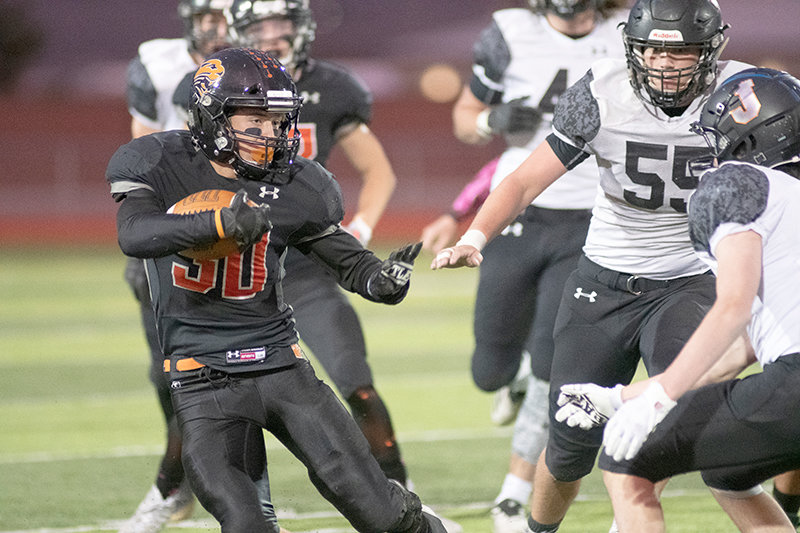 Running back Reed Smith prepares to stiff arm a defender in Powell's contest against Jackson Hole on Friday, Oct. 16. The Panthers finished the 2020 regular season with a 6-2 record.