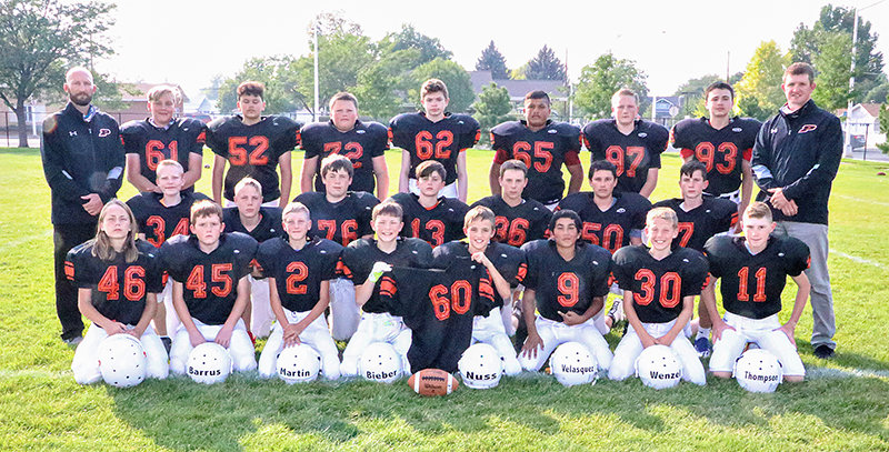 Members of the 2020 Powell Middle School seventh-grade football team pose for a team photo. Front row: Caleb Ashcraft, Ryan Barrus, Bryce Martin, Dominic Bieber, Talon Nuss, Marcos Velasquez, Tyler Wenzel, Weston Thompson. Middle row: Dawson Stayley, Keyton Miler, Daytona Menuey, Taeson Schultz, Casen Gines, Mason Coombs, Caiden Nelson. Back row: Juston Carter, Kane Blount, Rowan Diaz, Gunner Latunski, Aiden Simonson, Hugo Torres, Jace Hyde, Shane Kirkpatrick, Nick Fulton. Not pictured is Gabe Weimer, whose jersey is being held up.