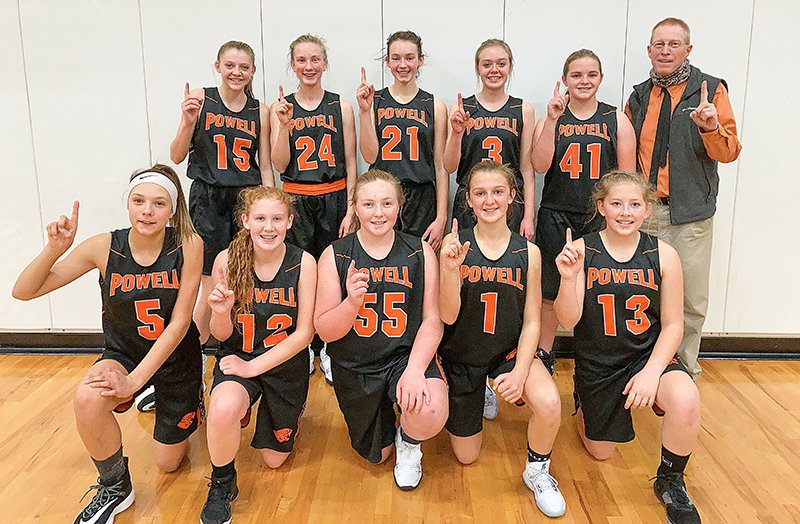 Members of the Powell Middle School eighth-grade girls' basketball A Team pose for a photo. The Cubs finished the year 13-1 and won the conference championship. Pictured are (from left) front row: Catelyn Floy, McKenna Cannon, Cami Gernhart, Alexa Richardson and Timber Neves; back row: Kodee Asay, Kenna Jabobsen, Saige Kidd, Ava Stearns, Anneliese Petersen and coach Dale Estes.