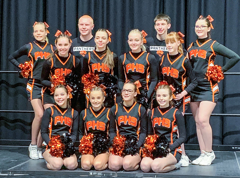 Members of the 2020-21 Powell High School cheer team pose for a team photo. Front row (from left): Olivia Wells, Morgan Schmidt, Jordan Howard and Kora Terry; middle row: Bella Bertagnole, Madi Black, Rylee White and Kathryn Brence; back row: Kinsley Braten, Geordan Weimer, Kolby Crichton and Alexa Nardini. Not pictured: Coaches Vicki Walsh and Cindy Jacobs.