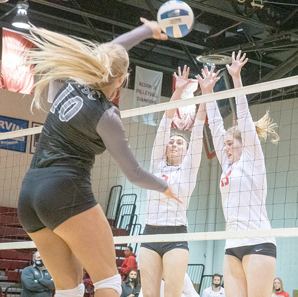 Northwest freshmen Sayler Larson and Karli Steiner go for a block Friday against Williston State College's Sydney Labatte. The Trappers finished the non-conference portion of their schedule with a 10-5 record.