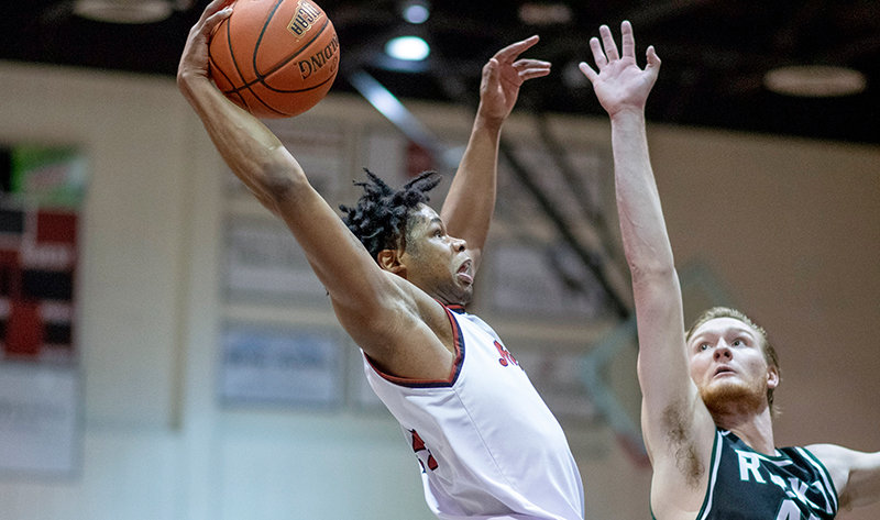 Sophomore Jerome Mabry posterizes Rocky Mountain College's Liam McKenny Wednesday in Northwest College's 96-72 win. The Trappers finished the non-conference portion of their schedule with a 6-4 record.