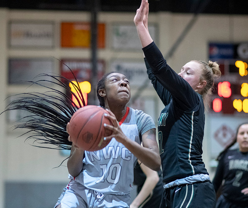 NWC sophomore Raquel Turner attempts an inside shot against a defender Thursday against Rocky Mountain. Turner and her teammates begin league play on Wednesday, facing Central Wyoming College in Riverton.