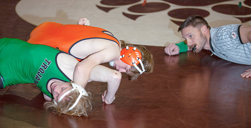 Logan Werner competes against Kelly Walsh's Jack Wilson in the Ron Thon Duals earlier this year. Werner went 3-0 at regionals, finishing first place in the 120 class.