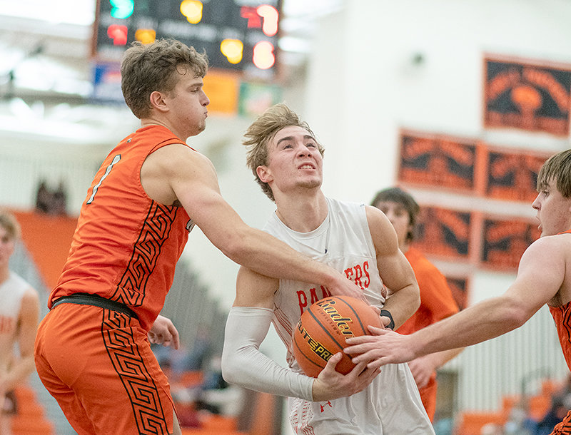 PHS senior Jaden Marchant drives into a crowded lane against Worland earlier this year. The Panthers went 1-1 last weekend, falling to Lyman Friday and bouncing back with a win over Mountain View Saturday.