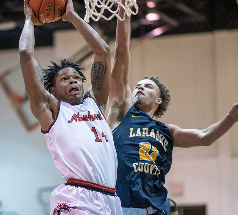 Jerome Mabry attempts to dunk over Laramie County's Xavier McCord Saturday in the Trappers' 82-74 loss to the Golden Eagles. Mabry notched 25 points on 11-of-16 shooting in Northwest's first home region game of 2021.