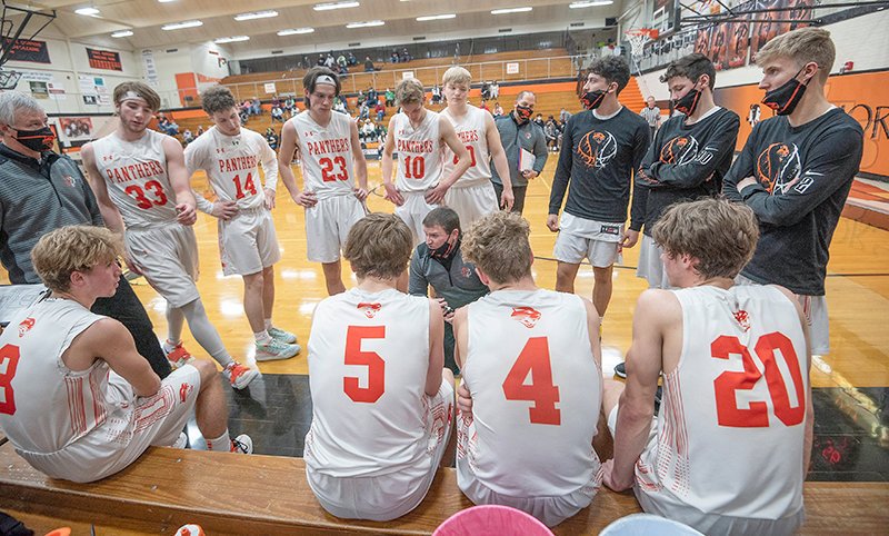 PHS head coach Mike Heny speaks with his players during the last timeout in the Panthers' Thursday game against Lander Valley. They fell 61-49, ending their season with a 14-5 record.