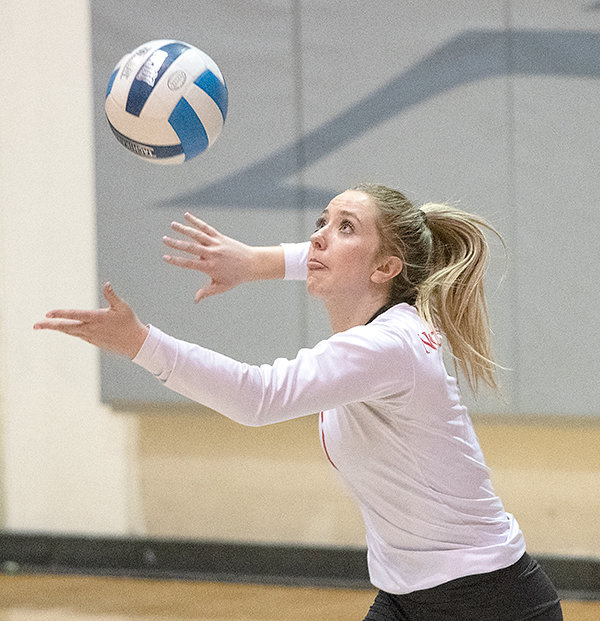 Libero Paige Weimer serves in Northwest's match against Laramie County earlier this season. After two disappointing sets Friday, the Trappers rallied in sets three through five to earn a win over WWCC.