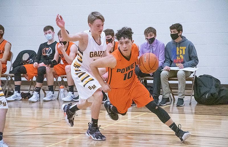Junior Dylan Escalante drives past a defender during a game against Rocky Mountain this season. The PHS JV boys' basketball team finished the season on a 10-game winning streak.