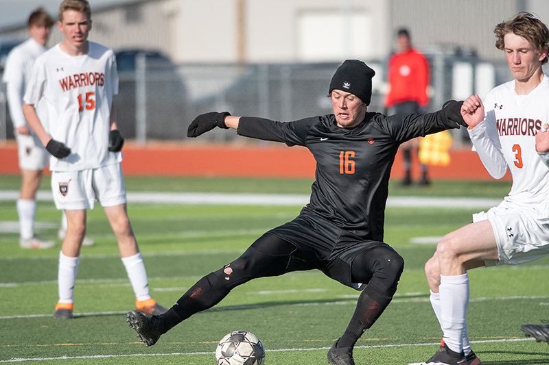 Powell High School senior Sam Bauer gains control of the ball Tuesday in Powell's 1-0 extra-time loss to Worland.