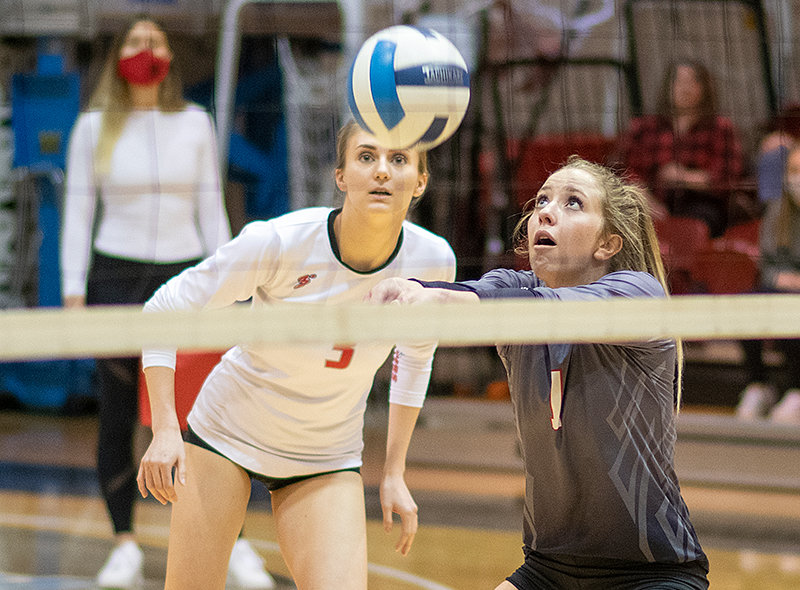 Paige Weimer records a dig in a NWC volleyball match earlier this year backed up by Sayler Larson (left). The Trappers showed growth as a program in 2021, winning eight more games than their previous campaign.