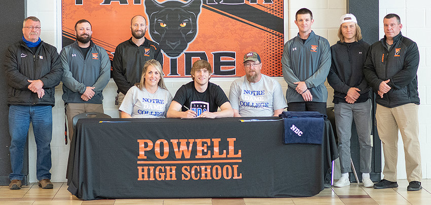 Seth Horton poses after signing a letter of intent to wrestle at Notre Dame College. Also pictured (from left) are: Nevin Jacobs, Cody Kalberer, Juston Carter, Lisa Horton, Duane Horton, Nick Fulton, Riley Bennett and Nate Urbach.