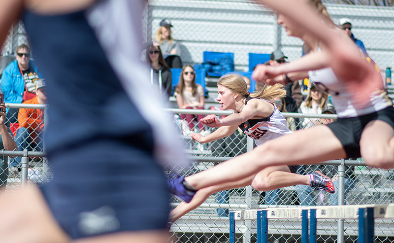 Lauryn Bennett competes in the 100 hurdles at a meet earlier this season. PHS track and field will compete in two events this coming weekend.