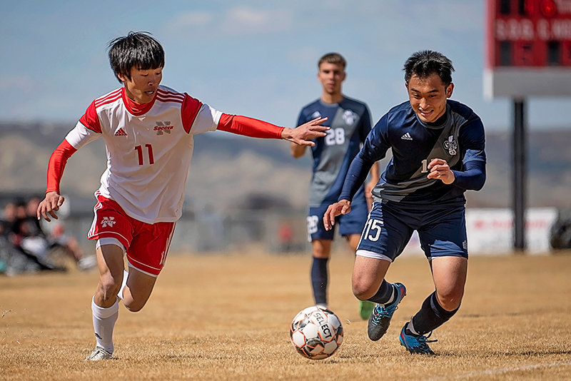 Taisei Goto (left) plays defense Saturday against Otero. NWC head coach Rob Hill hopes the team uses its most recent losses as a learning experience as it dives into the heat of the season.