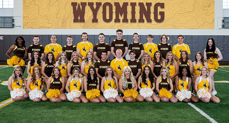 Members of the 2021-22 University of Wyoming cheer team pose for a photo. Despite PHS having boys' cheerleading for just two years, three Powell natives will be members of the UW team in the upcoming season.
