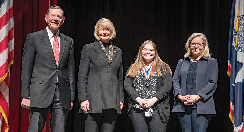 From left, U.S. Sens. John Barrasso and Cynthia Lummis (R-Wyo) and U.S. Rep. Liz Cheney present the Congressional Award to Kaitlyn Beavers. The medal ceremony was held at the Cheyenne Civic Center on Sunday.