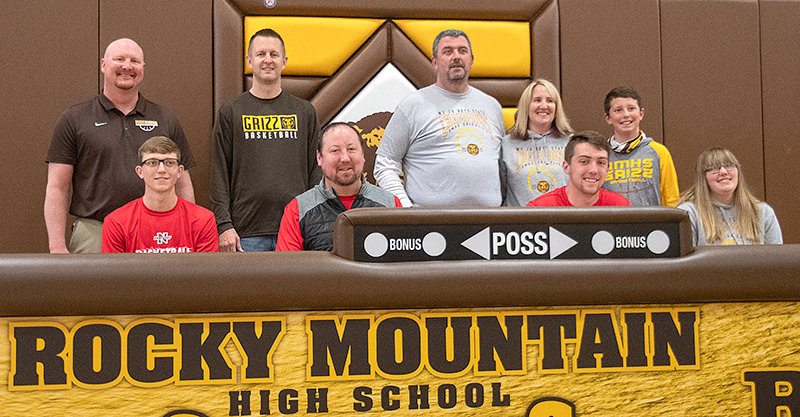 Jess Wambeke and Taylor Winland sign their letters of intent with Northwest College on Friday, with NWC coach Jay Collins on hand. Also pictured (from left): Ryan Boettcher, Jeff Samson, Pat Winland, Julie Winland, Cooper Winland and Rylee Winland.