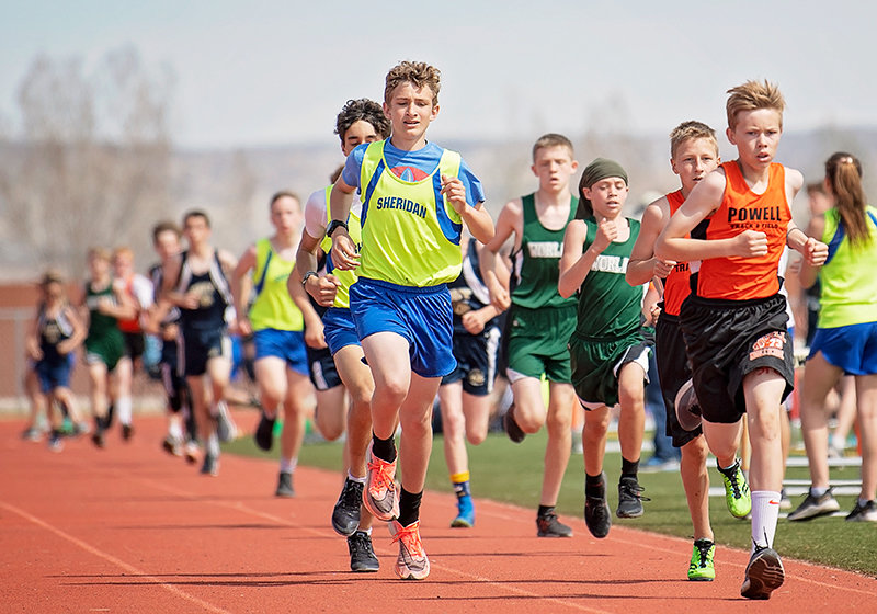 Korbyn Warren competes in the 1600 at Saturday's Powell Middle School Invitational, with Josh Pfeifer hot on his heels. Warren set the seventh-grade school record in 3200 with a time of 11:50.