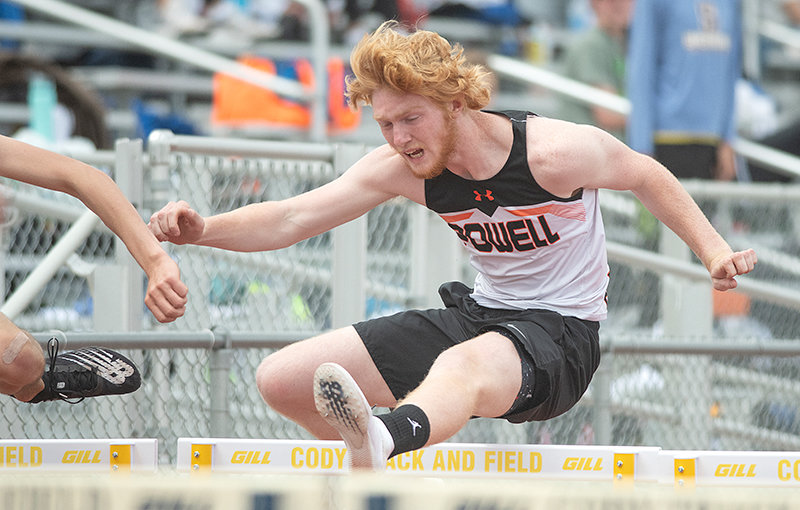 Eli Weimer clears a hurdle Friday in the 110 hurdles. In addition to placing fourth in that event, he won the high jump.