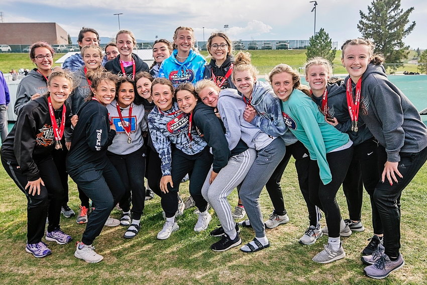 Members of the Powell High School girls' track team are all smiles after winning the title at the Class 3A state meet. They also won three individual titles.