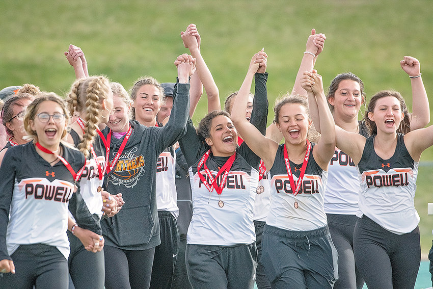 Powell High School girls' track and field athletes celebrate after winning the 3A state championship. The Panthers recorded 105 team points and finished well ahead of second-place Buffalo, which posted 71.