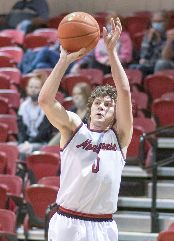 Hayden Peterson shoots a 3-pointer for Northwest College. The guard recently signed with Central Baptist College, an NAIA program in Arkansas.