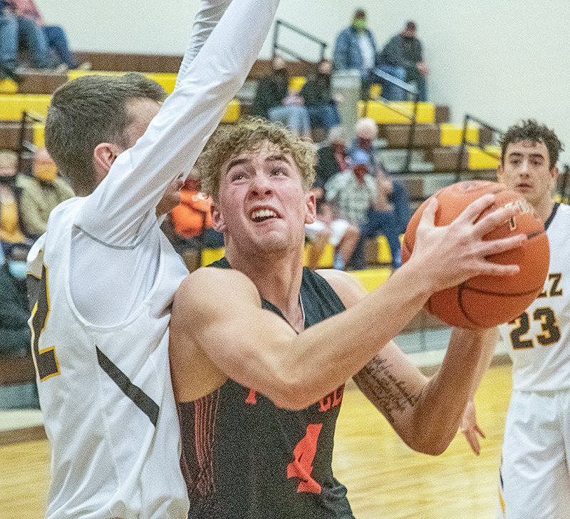 Mason Marchant attempts a layup against Rocky Mountain on Jan. 9. The recent PHS grad was one of 10 boys' basketball players selected to represent Wyoming in the Montana-Wyoming All-Star Basketball Series.