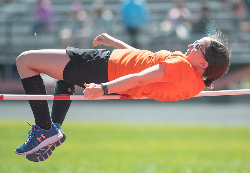Powell Middle School student Chloe Chouinard clears the bar during the sixth grade track meet on May 13. Despite the pandemic, the number of middle schoolers who participated in school sports and activities rose by roughly 14% from the prior year.