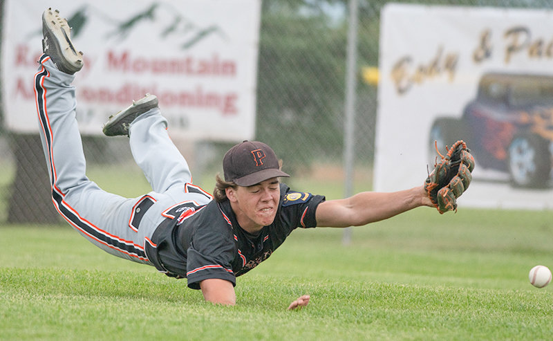 Outfielder Ryan Cordes lays out for a ball Wednesday against the World Showcase team. After a couple underwhelming performances, the Pioneers crushed their competition in Green River, outscoring opponents 42-3 in four games.