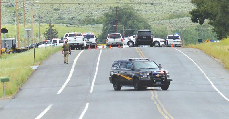 A Wyoming Highway Patrol vehicle blocks access to Sinks Canyon Road near Lander on Friday as officials investigate the scene of an officer-involved shooting. According to official reports, a man was killed and a trooper was injured in an exchange of gunfire that occurred after a traffic stop.