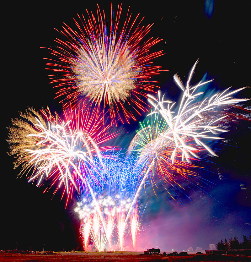 Fireworks light up the sky around Cowley Sunday night, during an Independence Day celebration. The annual event, hosted by David and Jennie Rael, returned in full force after being limited by COVID-19 a year ago.