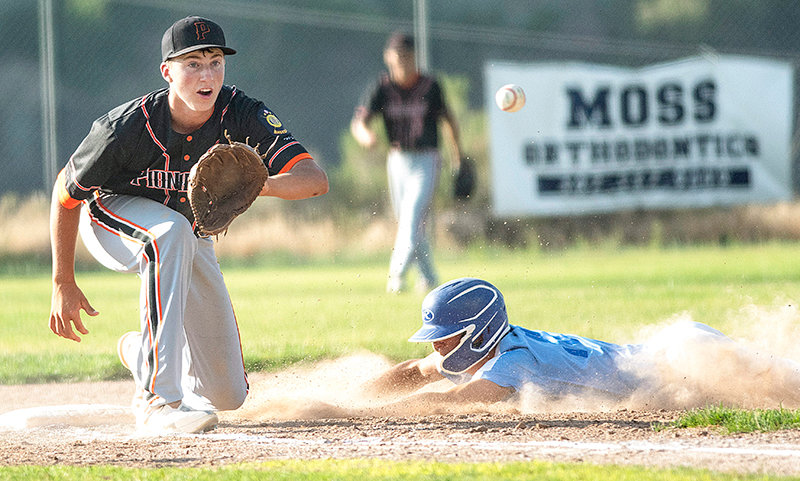 Pioneers third baseman Cade Queen attempts to tag a stealing runner out against Cody Tuesday. The Cubs again got the better of the Powell squad, sweeping the doubleheader at Mildward Simpson Field.