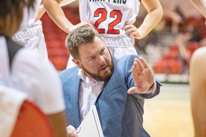 Northwest College head women's basketball coach Camden Levett speaks to his team in a game against Western Wyoming in March. After three seasons at the helm at NWC, Levett is joining Moberly Area Community College as an assistant.