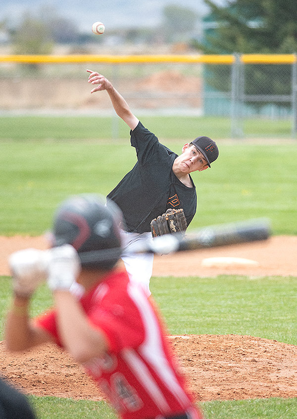 Jacob Gibson throws a pitch earlier in the season against the Lovell Mustangs. The Pioneers will compete at the state tournament in Gillette this weekend.