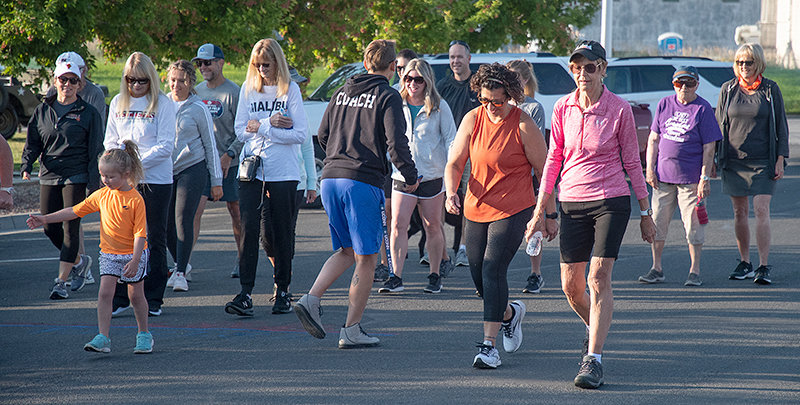 Walkers participate in Saturday's Orange and Black Fun Run. The event's proceeds were entirely donated to the PHS volleyball program. See Page 12 for more.